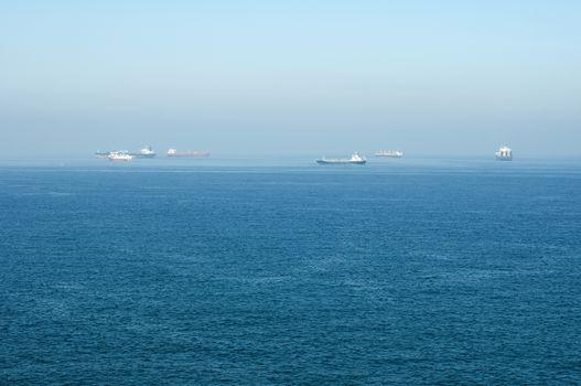 Cargo ships at sea.