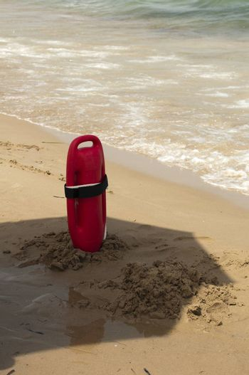 Red buoy for a lifeguard to save people from drowning