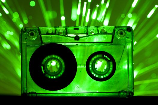 Transparent Cassette tape and green color disco lights background