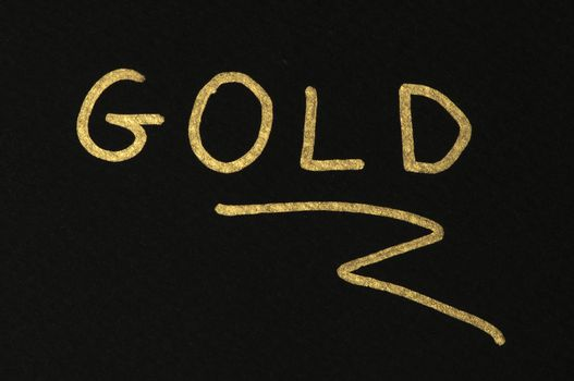Gold conception text over black