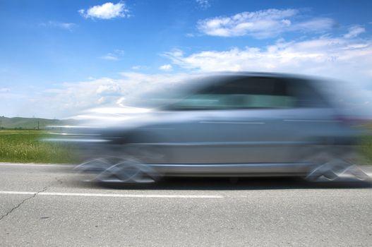 High speed blurred car on blue sky