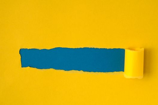 Yellow torn paper with blue space for text or other content