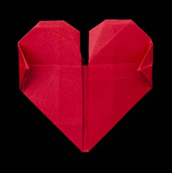 Origami red heart. Black isolated