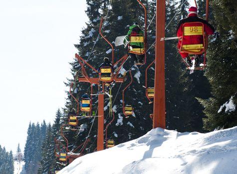 Ski lift and skiers.