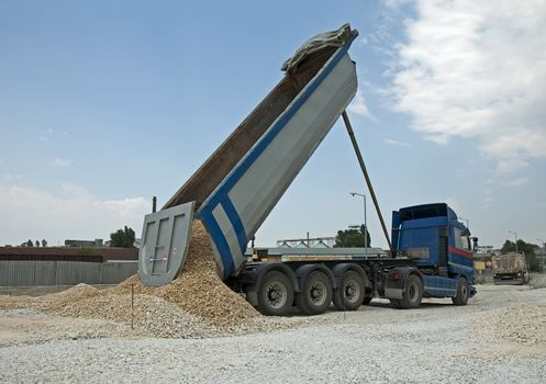 Blue Truck unload rocks