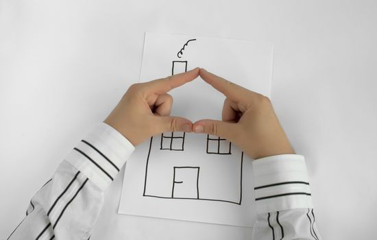 Painted house and two hands for roof. White background