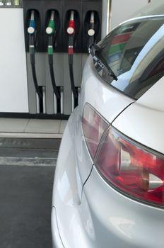 Gray car at a gas station.