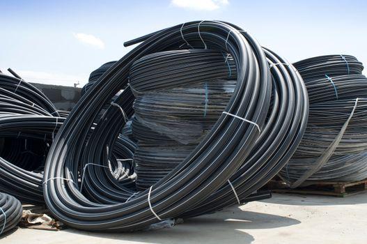 Coiled black PVC hoses. Polyethylene tubing