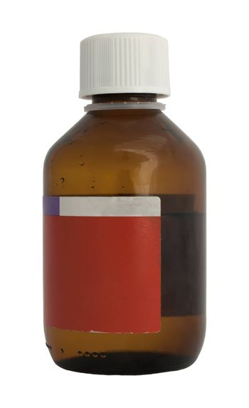 Brown medical bottle of medicine. White isolated
