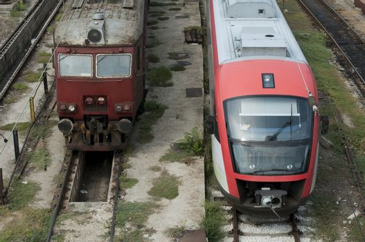 One new and one old train on the station