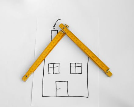 Drawed house and wooden meter for the roof