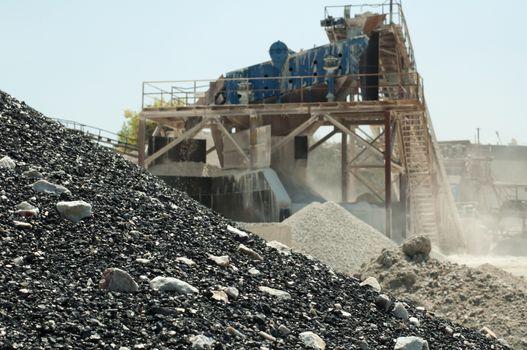 Stone quarry of limestone.Black asphalt pile the fore