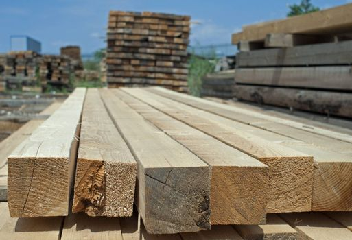 Timber. Planks and beams arranged