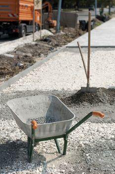 Tools for manual mixing of concrete. Bucket, shovel and wheelbarrow