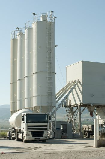 Cement factory and white truck loading cement