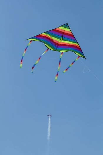 Kite in the foreground and aircraft. Vertical image