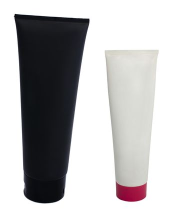 Black and white cosmetic tubes. White isolated
