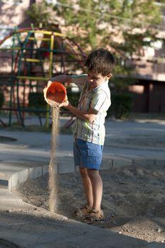 Children pour sand