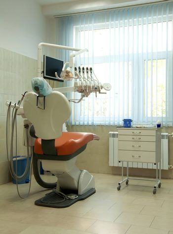 Dental surgery equipment. Chair and lighting