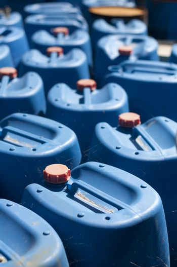 Ordered old blue canisters for oil products.