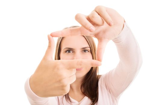 Close up of a young attractive woman making a camera frame with her hands and fingers, isolated on white background. Copy Space. Creativity and photography concept.