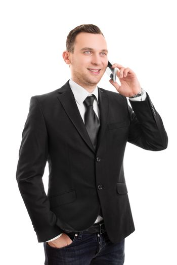 Portrait of a handsome young businessman talking on the mobile phone while standing, isolated on white background.