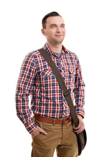 Portrait of a confident smiling casual man in plaid shirt and a shoulder bag standing, isolated on a white background.