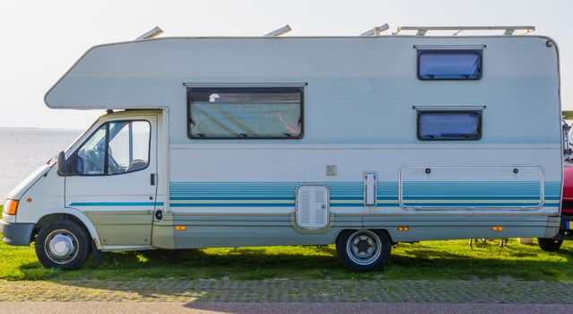 classical white camper, Mobile home for the holidays and travel, recreational automobile