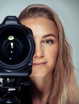 Beautiful woman with camera