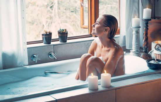 Woman with pleasure taking bath