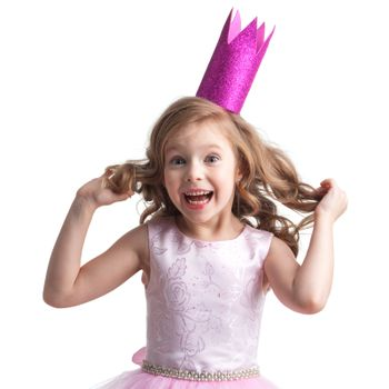 Little princess girl in pink dress and crown showing her curly blonde hair , studio isolated on white background