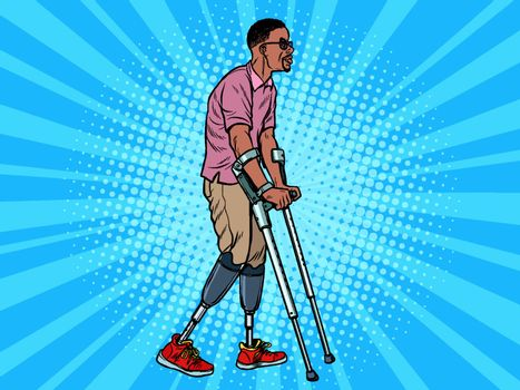 legless african veteran with a bionic prosthesis with crutches. a disabled man learns to walk after an injury. rehabilitation treatment and recovery