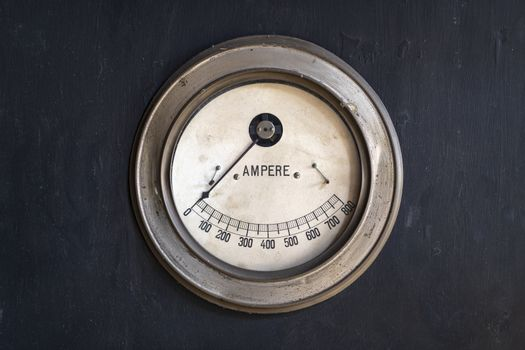 Old ammeter in a machine in a historic factory