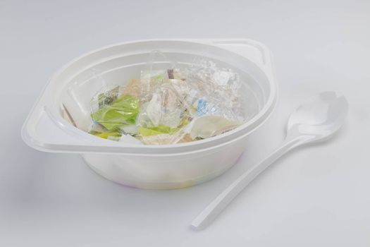 Conceptual visualization of the plastic soup problems by a plastic soup bowl filled with plastic and a plastic soup spoon