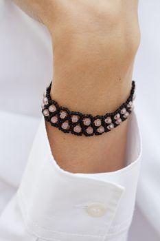 Stylish black bead bracelet on female hand