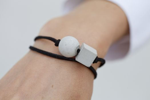 Stylish grey and black bead bracelet on female hand