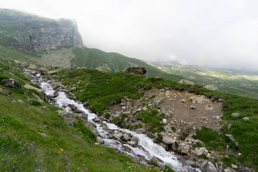 Waterfall in Italy Alps mountain landscape
