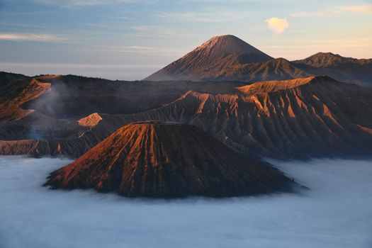 Bromo mountain with fog layer at sunrise, East Java, Indonesia