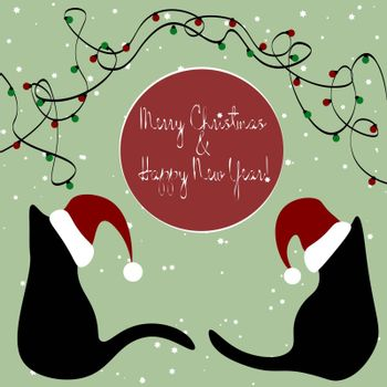 Christmas greeting card with pair of black cats sitting back to each other