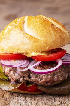 closeup of a hamburger on wood