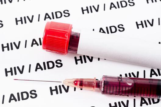 Sample blood for HIV test in syringe.
