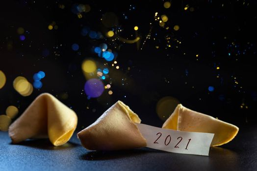 Label congratulating the new year 2021 on a lucky cookie, ideal for greeting cards.