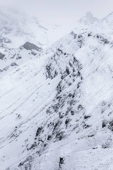 Aerial of snowcapped mountains in cloudy day of winter in Matterhorn Glacier Paradise, Zermatt, Switzerland.