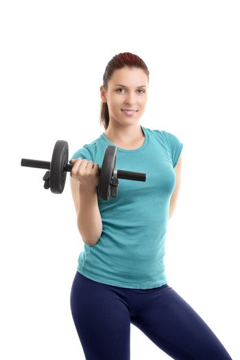 A portrait of a beautiful fit girl in sportswear, smiling and lifting a dumbbell, isolated on white background. Fit lifestyle concept.