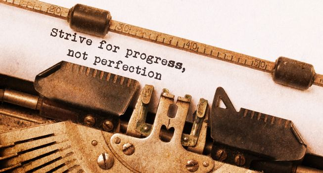 Strive for progress, not perfection - Written on an old typewrit