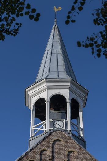 Historic wooden steeple of the church in the center of the village Midsland on the island of Terschelling in the northern Netherlands