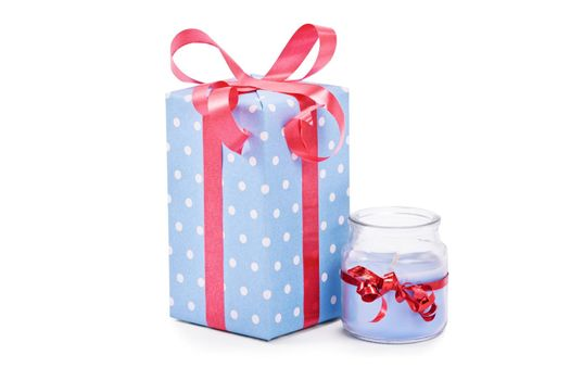 Cutely wrapped gift and candle, isolated on white background.