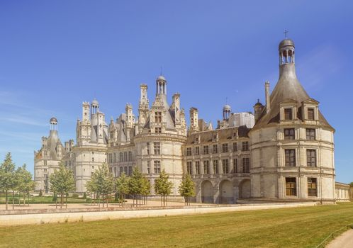 Famous Chambord castle in Loire valley by beautiful day, France