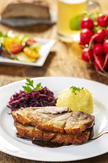 bavarian roasted pork with dumplings and cabbage
