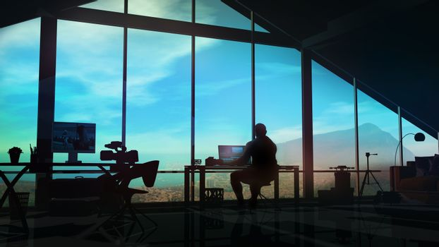 The silhouette of a videographer at a workplace in his office.